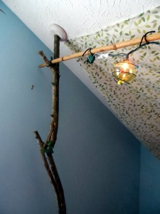 "Using branches as posts to hold ""fairy lights"" took some creative carpentry work!"